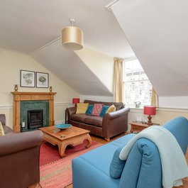 Bright airy living room with traditional sash and case dormer window