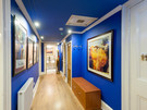 Haymarket Terrace 6 - Hallway with blue walls and framed paintings in Edinburgh holiday let