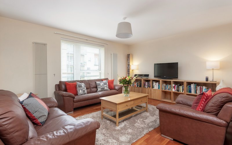 Holyrood Road 1 - Spacious family living room with comfortable leather seating