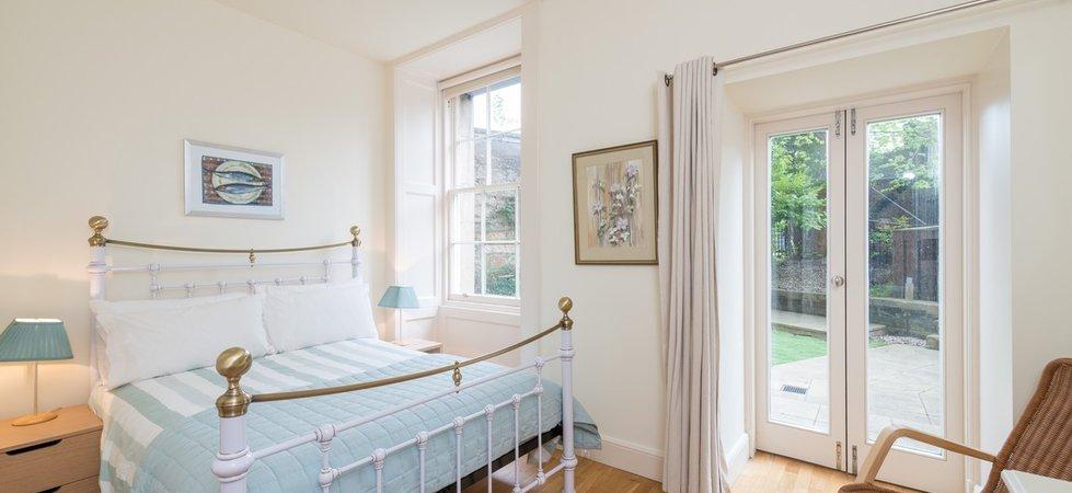 Light, spacious bedroom with patio doors