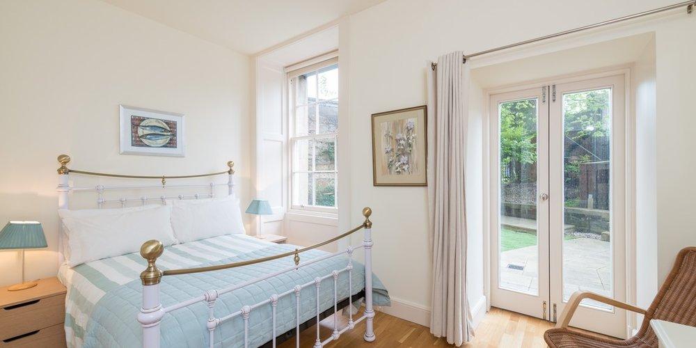 Drumsheugh Gardens Apartment Bedroom - Light, spacious bedroom with patio doors