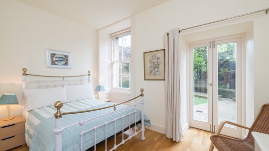 Drumsheugh Gardens Apartment Bedroom - Light, spacious bedroom with patio doors