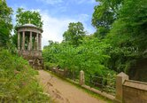 Iconic St Bernard's Well in a lush background