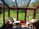 Self catering Gullane.  - This is a lovely sun room , where you can relax and enjoy the view of the Garden, Gullane. East Lothian