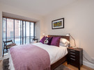Patriothall 3 - Double bedroom with decorative purple blanket and cushions in Edinburgh holiday let