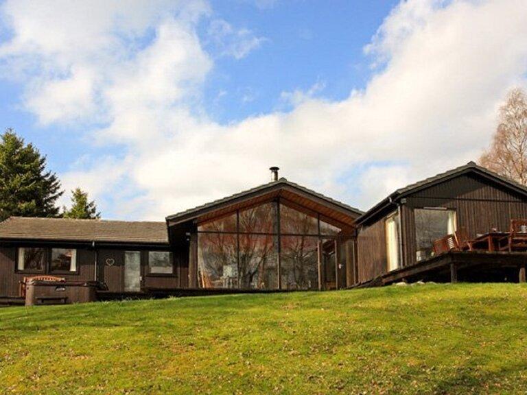 Ptarmigan Lodge - 4 Bed Home with Hot Tub. External shot from the back garden (© Dunpark Property Agents)