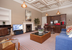 The large and luminous living space and open plan kitchen