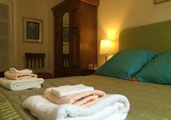 The comfortable king size room has a mediterranean feel