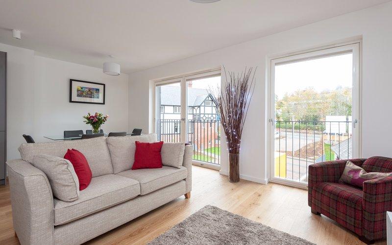 Cruickshank Gardens 1 - Contemporary open plan living area with large, bright windows