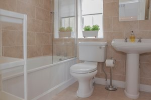 The main bathroom is traditionally elegant while featuring modern details, such as the heated mirror.