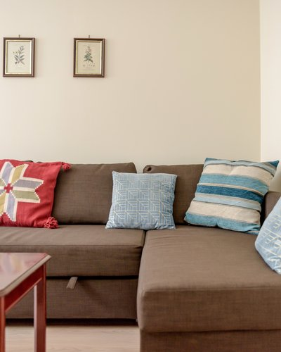 Eyre Crescent 3 - Brown sofa feature decorative cushions.