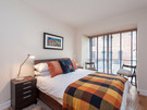 Patriothall 2 - Double bedroom with decorative blanket and cushions in Edinburgh holiday let