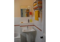 Our family bathroom, recently refurbished, with a bath and shower over.