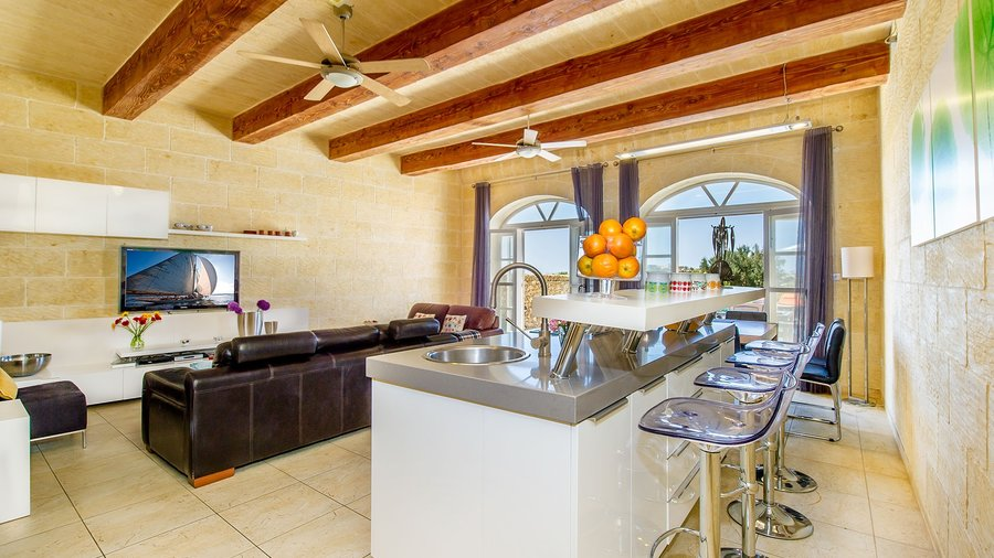 Inside your Gozo Airbnb - A contemporary entire Villa with a top class kitchen and communal island to enjoy breakfast during your holiday, Gozo, Malta.