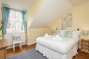 Spacious double bedroom with sash and case window