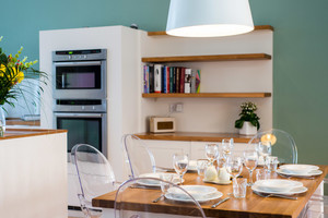 Albany Street Townhouse Dining Kitchen - Table set for dinner with kitchen in the background