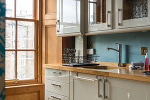 Kitchen sink, units and window overlooking rear gardens of holiday flat.