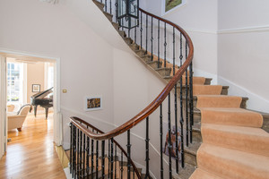 Albany Street Townhouse Staircase - Sweeping Staircase with a glimpse into Lounge with grand piano