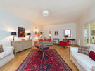 Drumsheugh Gardens Apartment Lounge - Large lounge with red rug in the centre and artwork on the walls.