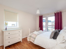 The Park (Holyrood Road) 5 - Double bedroom with chest of drawers and tartan throw