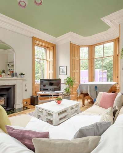 Millerfield Place 2 - Family living room with large bay window providing green views in Edinburgh holiday let