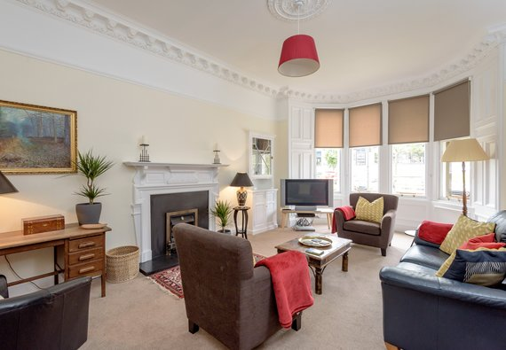 LauderdaleSt-00001 - Large family living room with hand picked furnishings and Victorian bay windows
