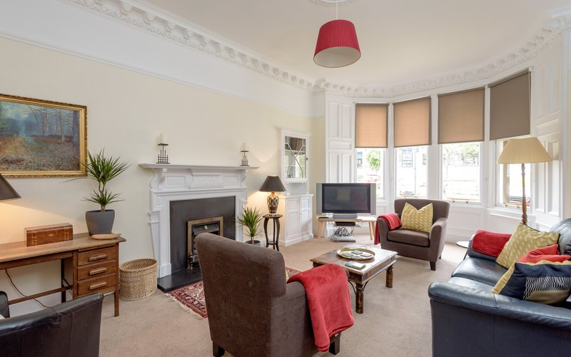 Lauderdale Street 1 - Large family living room with hand picked furnishings and Victorian bay windows