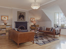 Sitting Room - Featuring an elegant fireplace and stunning views. (© The Edinburgh Address)