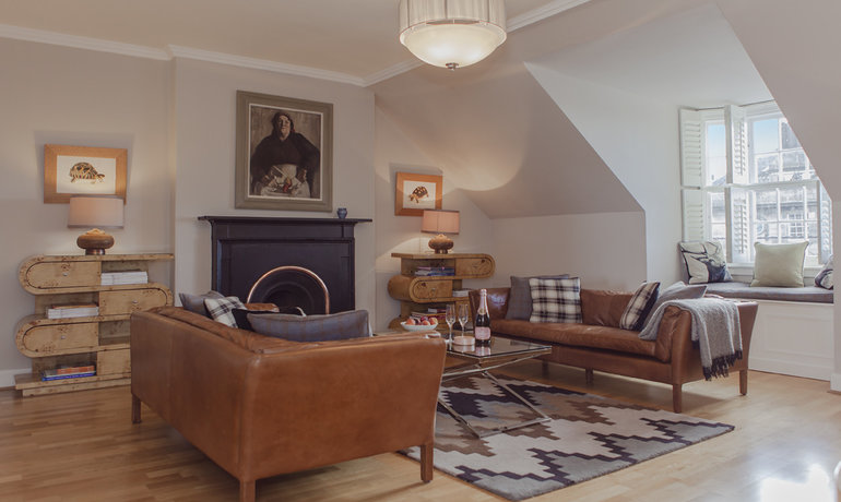 Sitting Room - Featuring an elegant fireplace and stunning views. (© The Edinburgh Address)