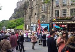 The apartment faces the Grassmarket Square with a host of bars and restaurants