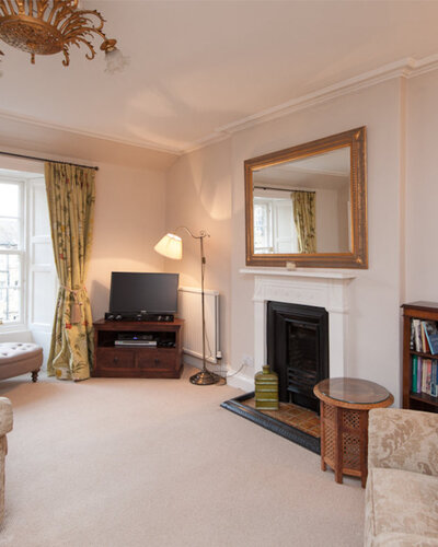 Hart Street Apartment-16 - Family living room with large wall mirror and TV in luxury Edinburgh holiday let