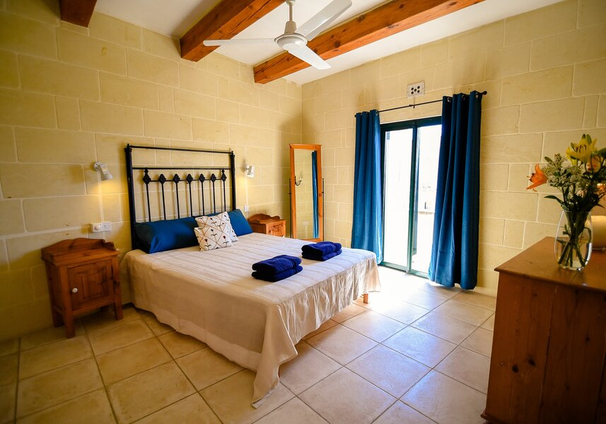 14. Main bedroom with ensuite and terrace overlooking pool area